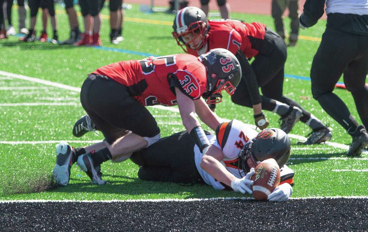 Mechanicville defensive back Alex Amoroso tackles Schuylerville running back Sam McGarrahan at the end zone during a game Saturday, Mar. 20, 2021, in Mechanicville, N.Y. (Jenn March, Special to the Times Union )