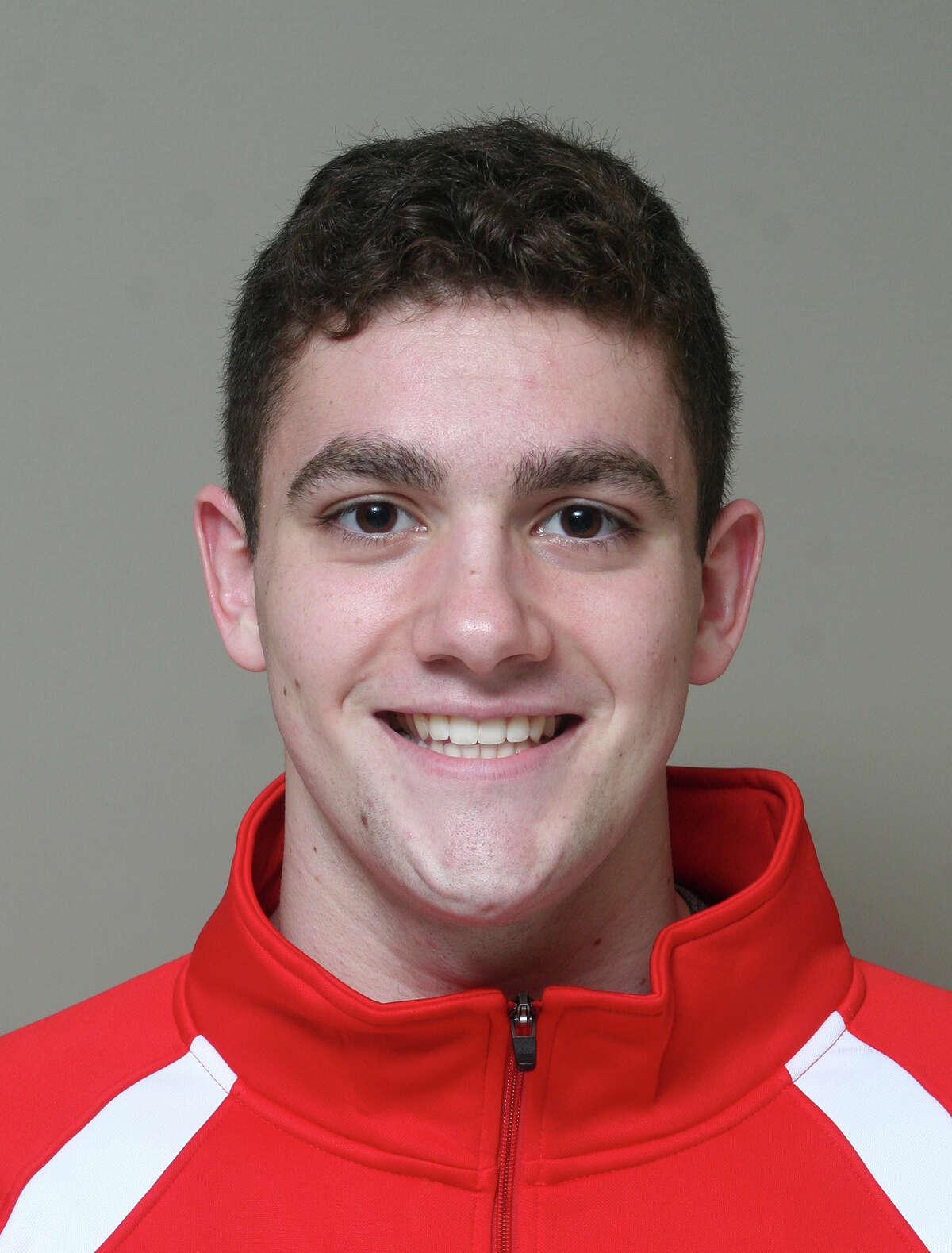 Burnt Hills-Ballston Lake graduate Liam Picozzi, center, of the Denison swim team.