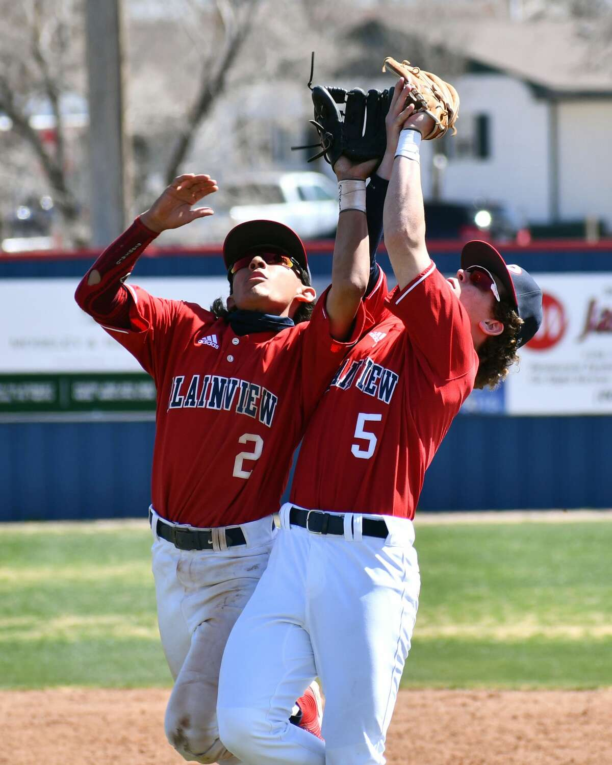 Plainview's Austin Hauk (5) narrowly avoids a collision with teammate Devin Rogers for the game-ending out in a 5-3 victory over Amarillo Tascosa in a District 3-5A baseball game on Saturday at Bulldog Park.