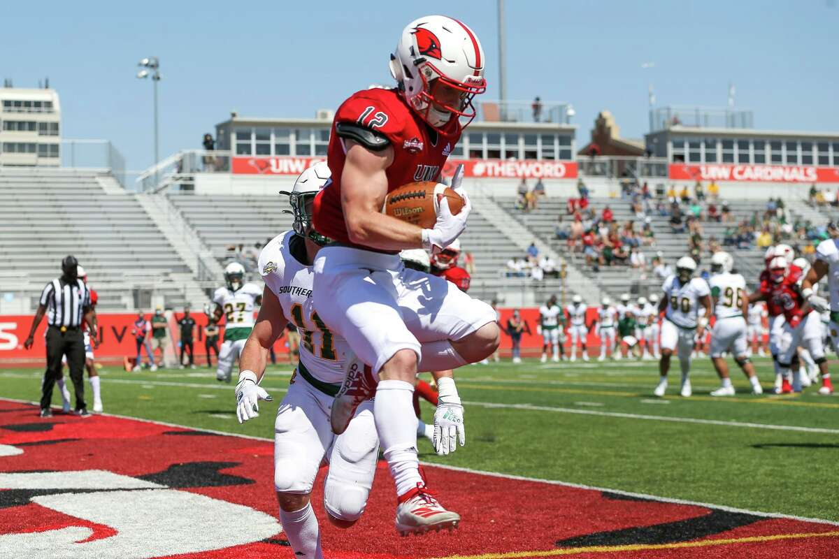 UIW's Robert Ferrel comes down with a 7-yard touchdown reception in the end zone during their first home game of the spring Southland Conference season against Southeastern Louisiana at Gayle and Tom Benson Stadium on Saturday, March 20, 2021.