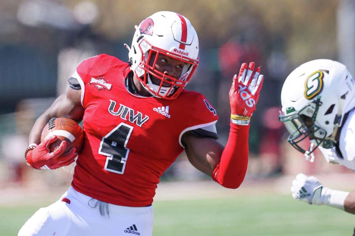 UIW running back Kevin Brown looks to take on a defender during their first home game of the spring Southland