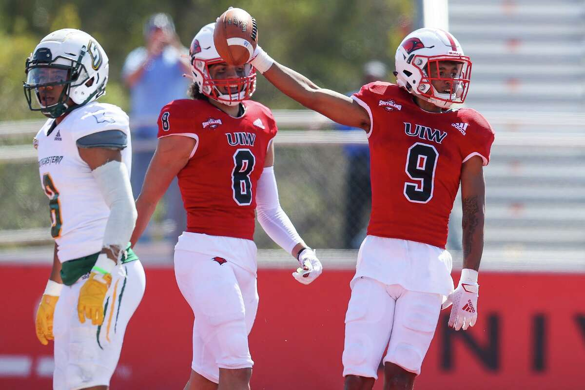 UIW's Tre Wolf, right, celebrates his 25-yard touchdown reception in the first half of their first home game of the spring Southland Conference season against Southeastern Louisiana at Gayle and Tom Benson Stadium on Saturday, March 20, 2021.
