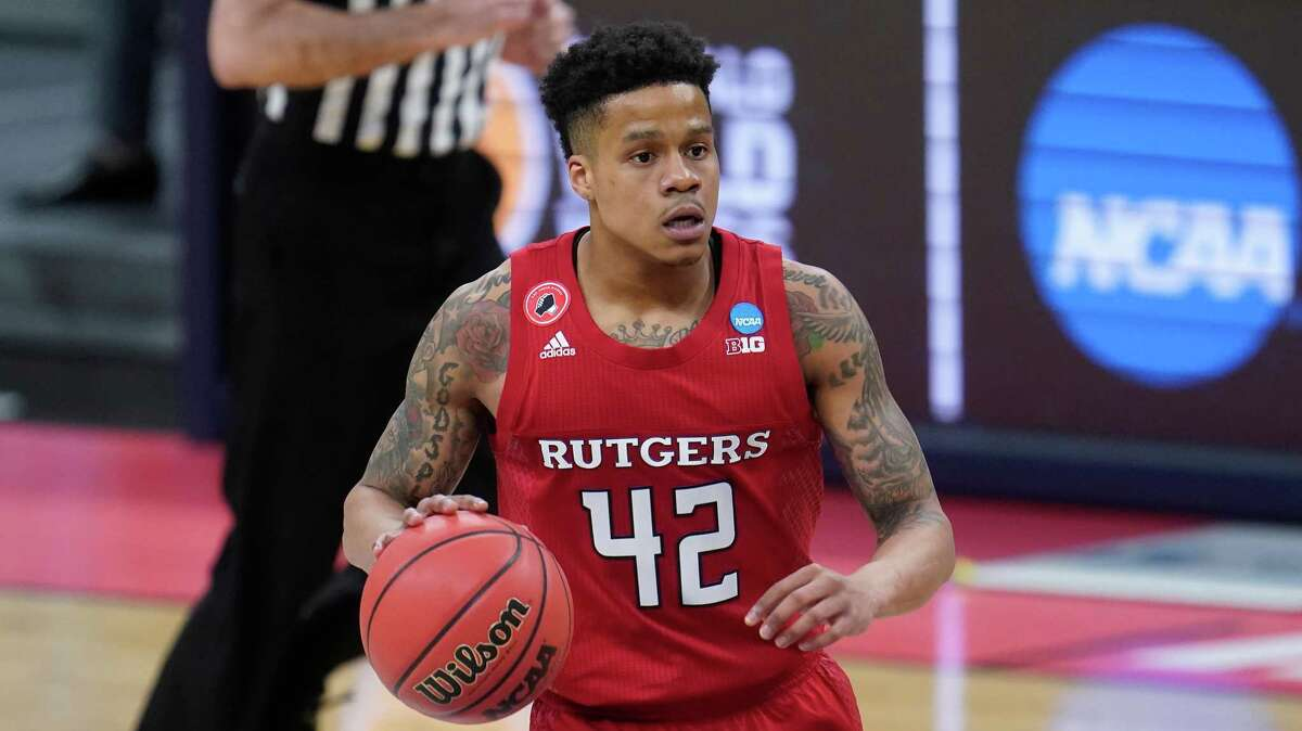 Rutgers gaurd Jacob Young couldn't help but look ahead on the bracket when he saw the University of Houston, where he father played, could match up with his team.