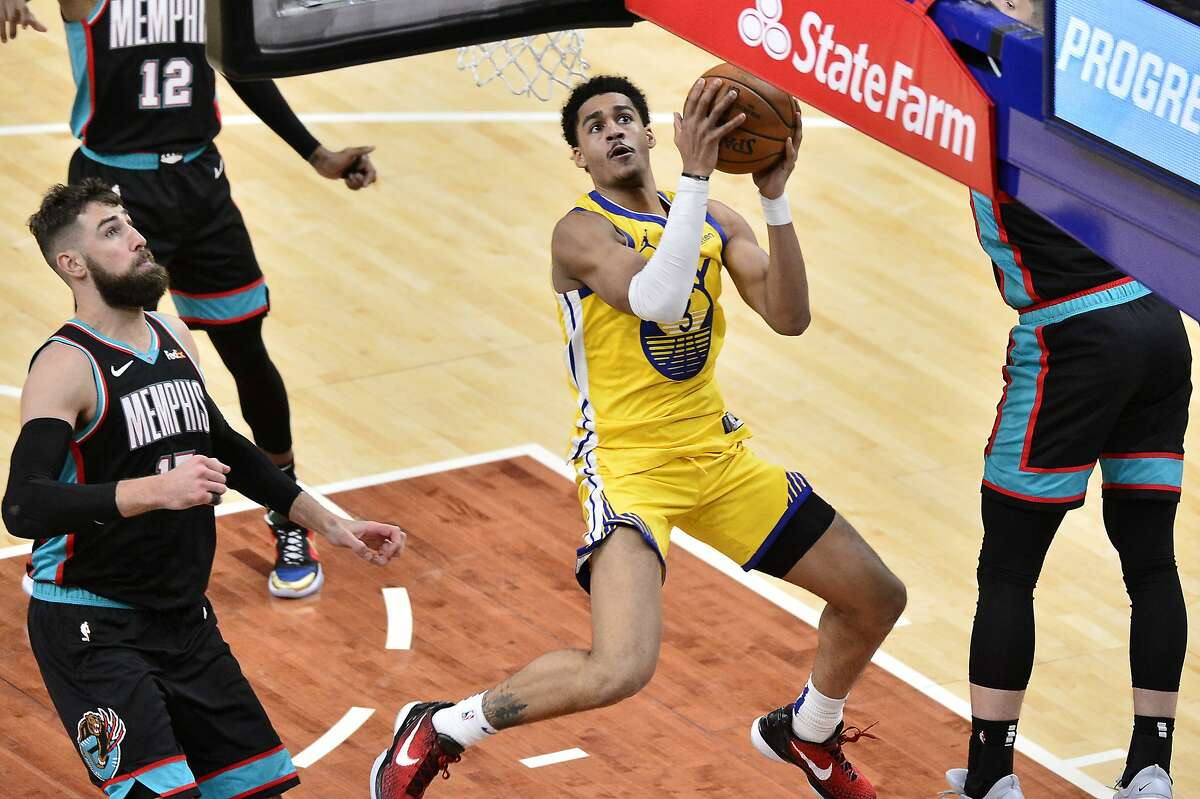 Grizzlies center Jonas Valanciunas (left) is one of many NBA players unable to keep Warriors guard Jordan Poole from scoring. Poole has looked like a first-round draft pick since returning from the G League's bubble.