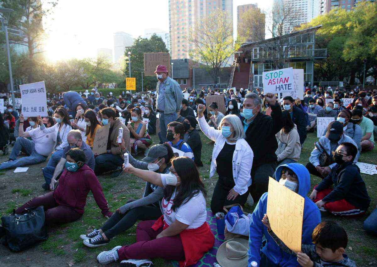 """People gather to participate a """"Stop Asian Hate Vigil & Rally"""" to mourn the six Asian American victims killed in Atlanta and denounce a rise in hate incidents and violence targeting Asian Americans Saturday, March 20, 2021, at Discovery Green in Houston."""
