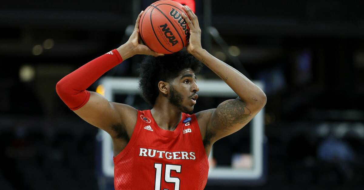 Myles Johnson #15 of the Rutgers Scarlet Knights controls the ball in the second half against the Clemson Tigers in the first round game of the 2021 NCAA Men's Basketball Tournament at Bankers Life Fieldhouse on March 19, 2021 in Indianapolis, Indiana. (Photo by Sarah Stier/Getty Images)