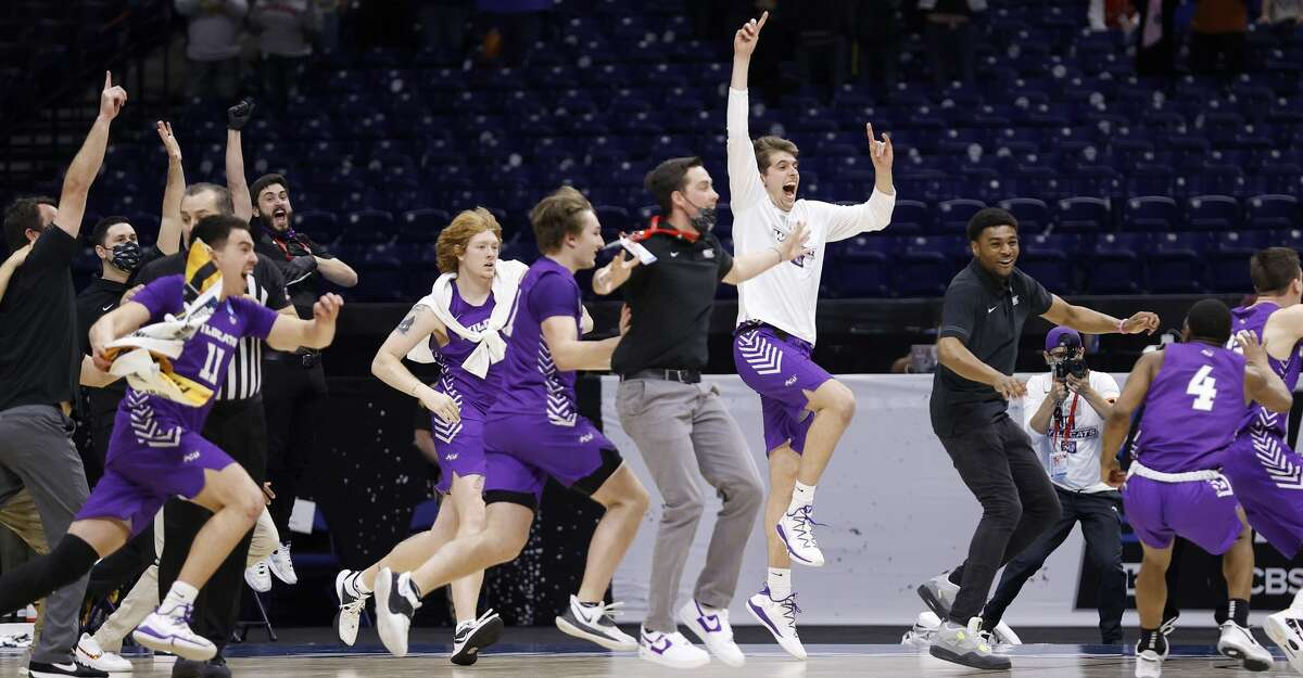 Abilene Christian Wildcats celebrate after defeating Texas Longhorns 53-52 in the first round game of the 2021 NCAA Men's Basketball Tournament at Lucas Oil Stadium on March 20, 2021 in Indianapolis, Indiana. (Photo by Jamie Squire/Getty Images)
