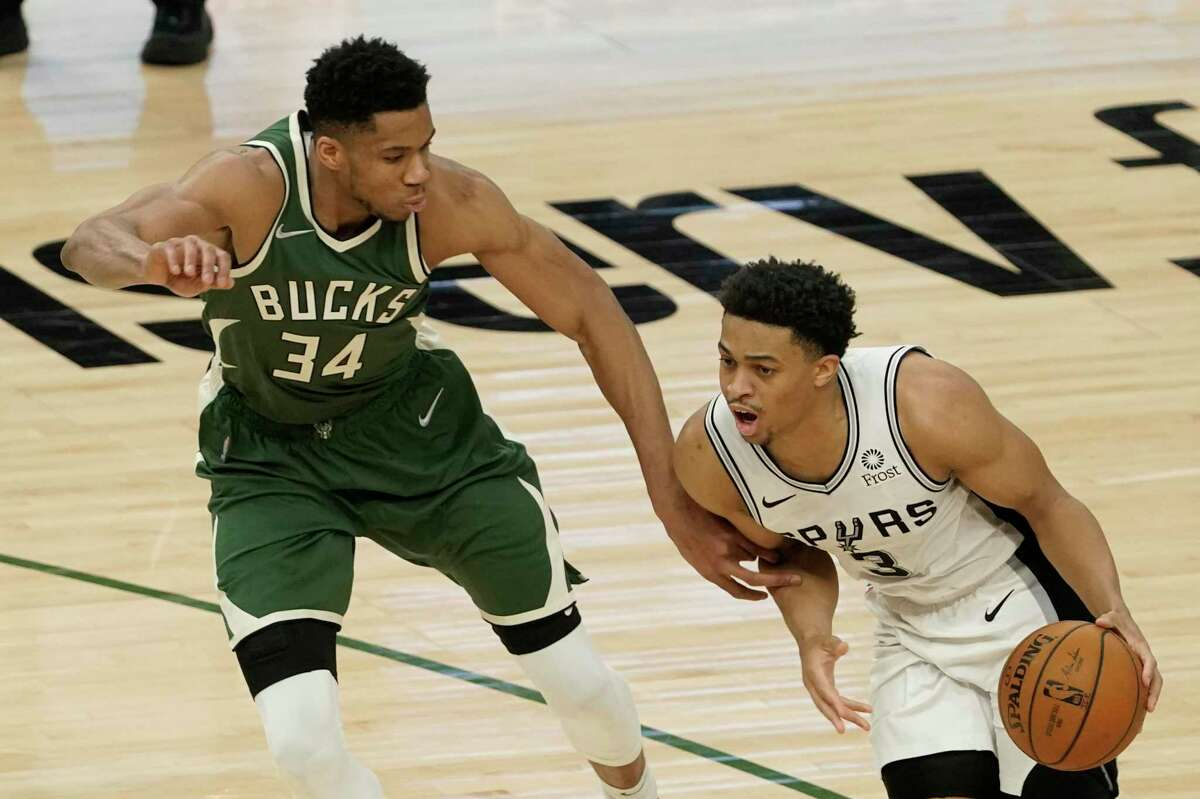 Spurs' Keldon Johnson tries to drive past Milwaukee Bucks' Giannis Antetokounmpo during the second half of an NBA game on Saturday, March 20, 2021, in Milwaukee.