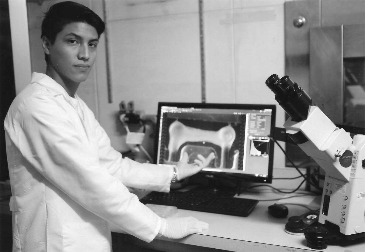 Miguel Chavez stands in the microscope room at Columbia University, imaging his newly seeded cardiac tissue. The purpose of producing these tissues is to recreate human physiology to then recapitulate certain diseases that affect heart tissue, investigate potential drug therapies and gain greater insight into the pathophysiology by modeling cardiac diseases. (Photo courtesy Miguel Chavez)