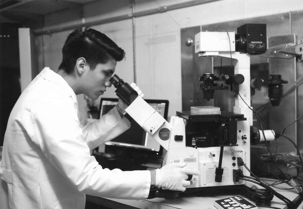 Miguel Chavez is at Columbia University Laboratory for Stem Cells and Tissue Engineering looking at newly transfected stem cells using fluorescent microscopy to verify whether his cells have been transformed. (Photo courtesy Miguel Chavez)