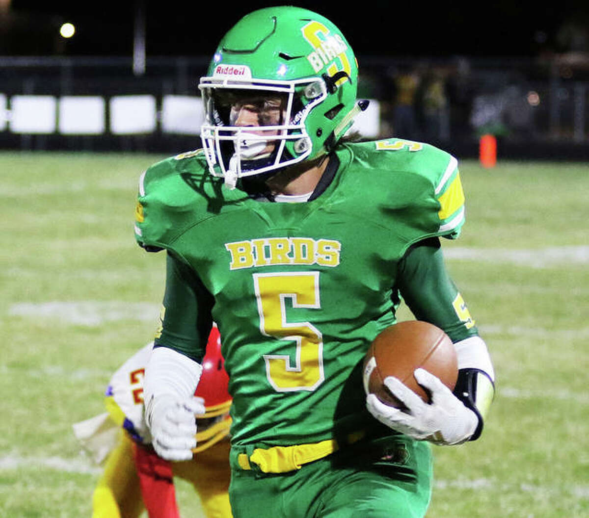 Roxana's Gavin Day, shown in open field in a game last season against Roxana, on Saturday rushed for 155 yards in the Piasa Birds' victory over PORTA at Petersburg.
