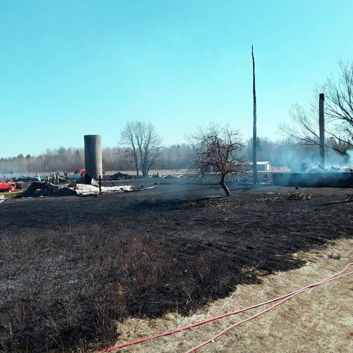 What started out as a grass fire ended in the loss of a farmhouse, two barns and several other structures on Dorothy Road on southeast of Wellston on Saturday.(Courtesy photo/Jack VanderBie)