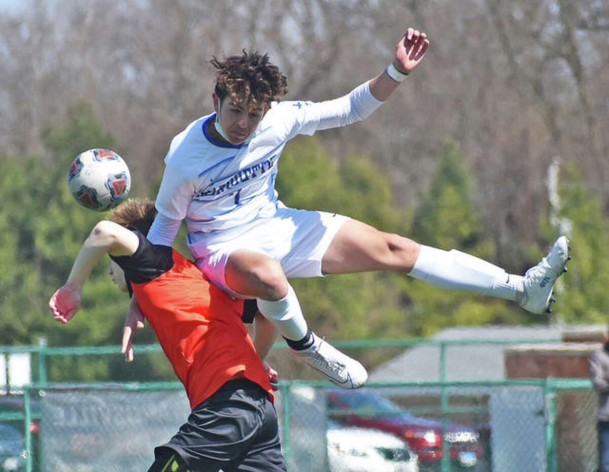 Marquette's Myles Paniagua (top) collides with Edwardsville defender Jack Heiderscheid going for a 50-50 ball as time expires in the second half on Saturday afternoon at the District 7 Sports Complex in Edwardsville.
