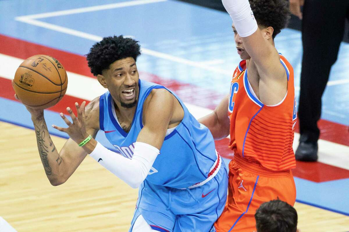 Houston Rockets center Christian Wood (35) looks to pass during the first quarter of an NBA game between the Houston Rockets and Oklahoma City Thunder on Sunday, March 21, 2021, at Toyota Center in Houston, TX.