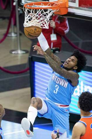 Houston Rockets guard Kevin Porter Jr. (3) dunks during the first quarter of an NBA game between the Houston Rockets and Oklahoma City Thunder on Sunday, March 21, 2021, at Toyota Center in Houston, TX. Photo: Mark Mulligan, Staff Photographer / © 2021 Mark Mulligan / Houston Chronicle