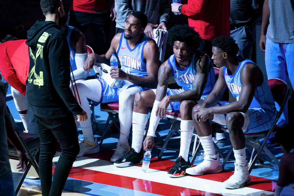Houston Rockets forward Sterling Brown (0) and Houston Rockets guard Kevin Porter Jr. (3) sit on the sideline during a timeout during the second quarter of an NBA game between the Houston Rockets and Oklahoma City Thunder on Sunday, March 21, 2021, at Toyota Center in Houston.