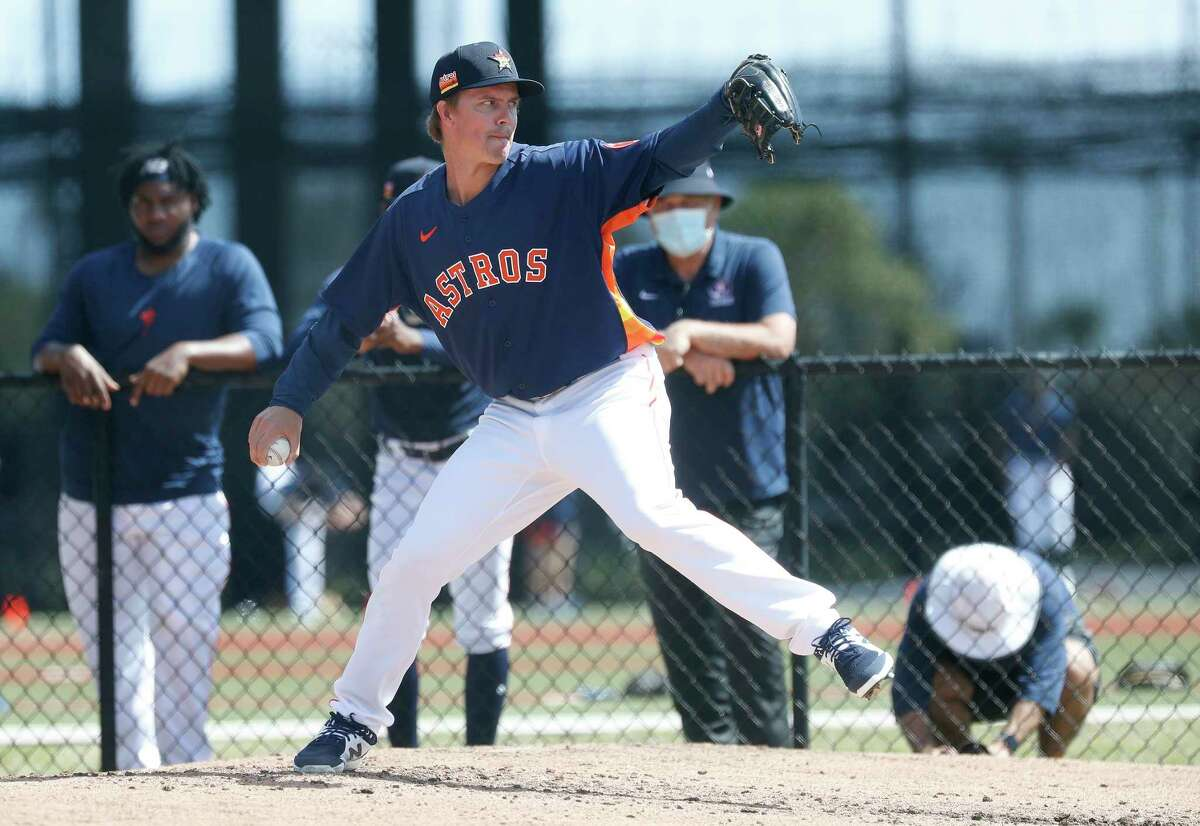 Houston Astros pitcher Zack Greinke (21) throws a bullpen session during spring training workouts for the Astros at Ballpark of the Palm Beaches in West Palm Beach, Florida, Sunday, February 28, 2021.