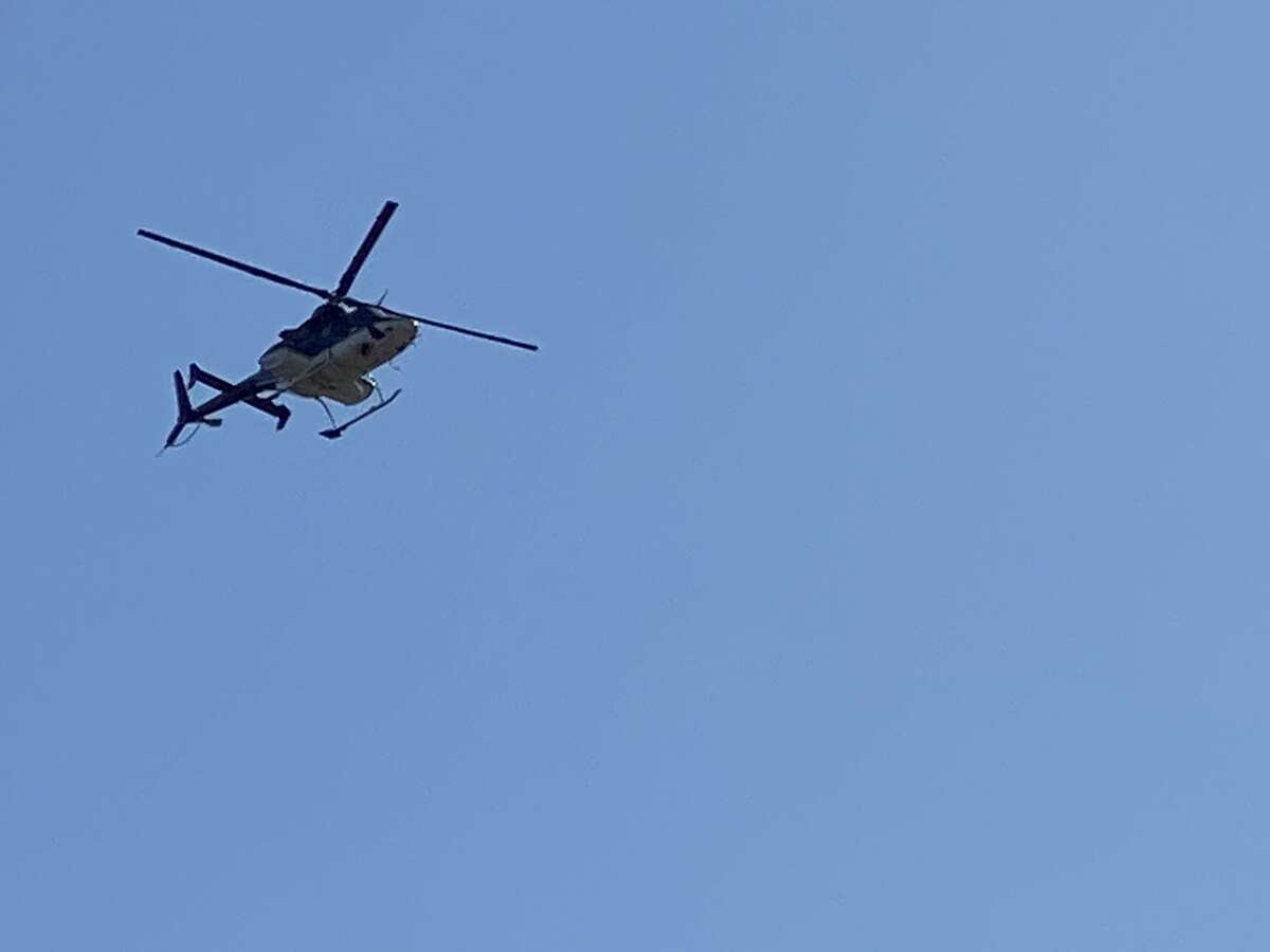 A photo of a helicopter searching for two missing children from Regent Street in Niskayuna on Sunday, March 21, 2021.