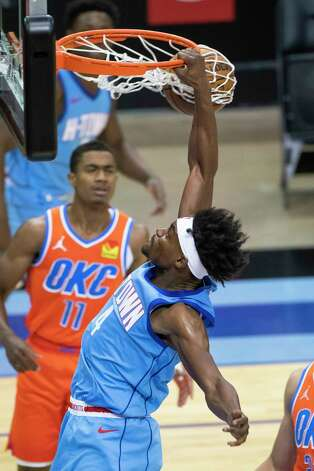 Houston Rockets forward Danuel House Jr. (4) dunks during the third quarter of an NBA game between the Houston Rockets and Oklahoma City Thunder on Sunday, March 21, 2021, at Toyota Center in Houston, TX. Photo: Mark Mulligan, Staff Photographer / © 2021 Mark Mulligan / Houston Chronicle