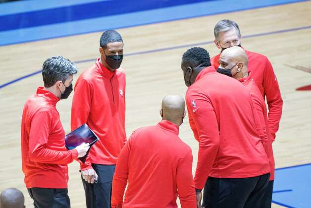The Rockets coaching staff huddle during a timeout during the third quarter of an NBA game between the Houston Rockets and Oklahoma City Thunder on Sunday, March 21, 2021, at Toyota Center in Houston, TX. Photo: Mark Mulligan, Staff Photographer / © 2021 Mark Mulligan / Houston Chronicle
