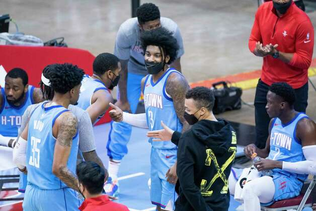Houston Rockets guard Kevin Porter Jr. (3) talks to his teammates on the bench during a timeout during the third quarter of an NBA game between the Houston Rockets and Oklahoma City Thunder on Sunday, March 21, 2021, at Toyota Center in Houston, TX. Photo: Mark Mulligan, Staff Photographer / © 2021 Mark Mulligan / Houston Chronicle