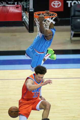 Houston Rockets forward Danuel House Jr. (4) dunks over Oklahoma City Thunder center Isaiah Roby (22) during the third quarter of an NBA game between the Houston Rockets and Oklahoma City Thunder on Sunday, March 21, 2021, at Toyota Center in Houston, TX. Photo: Mark Mulligan, Staff Photographer / © 2021 Mark Mulligan / Houston Chronicle