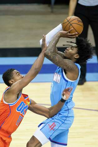 Houston Rockets guard Kevin Porter Jr. (3) shoots over Oklahoma City Thunder guard Theo Maledon (11) during the third quarter of an NBA game between the Houston Rockets and Oklahoma City Thunder on Sunday, March 21, 2021, at Toyota Center in Houston, TX. Photo: Mark Mulligan, Staff Photographer / © 2021 Mark Mulligan / Houston Chronicle