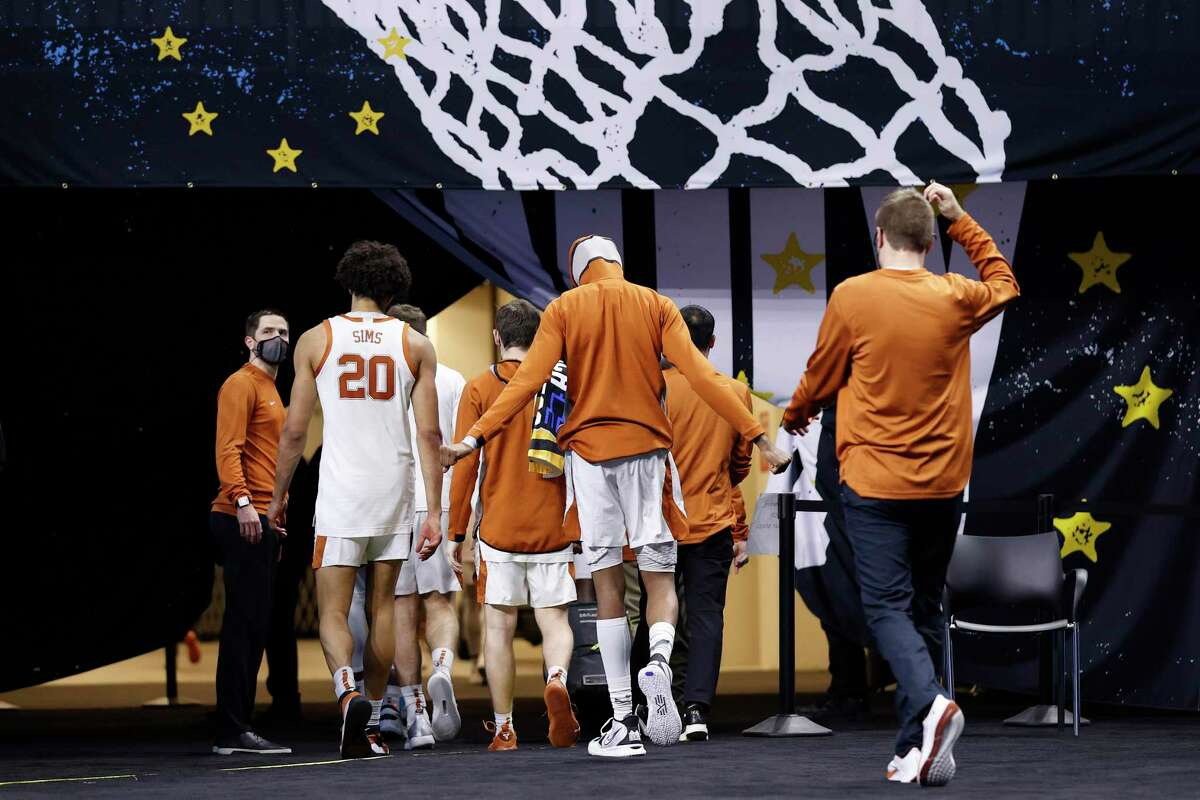 INDIANAPOLIS, INDIANA - MARCH 20: Texas Longhorns players walk off the court after losing to Abilene Christian Wildcats 53-52 in the first round game of the 2021 NCAA Men's Basketball Tournament at Lucas Oil Stadium on March 20, 2021 in Indianapolis, Indiana. (Photo by Jamie Squire/Getty Images)