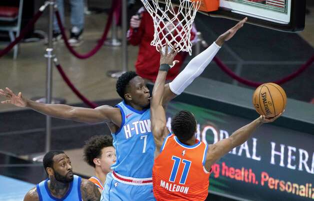 Houston Rockets guard Victor Oladipo (7) tries to stop a shot by Oklahoma City Thunder guard Theo Maledon (11) during the fourth quarter of an NBA game between the Houston Rockets and Oklahoma City Thunder on Sunday, March 21, 2021, at Toyota Center in Houston, TX. Photo: Mark Mulligan, Staff Photographer / © 2021 Mark Mulligan / Houston Chronicle