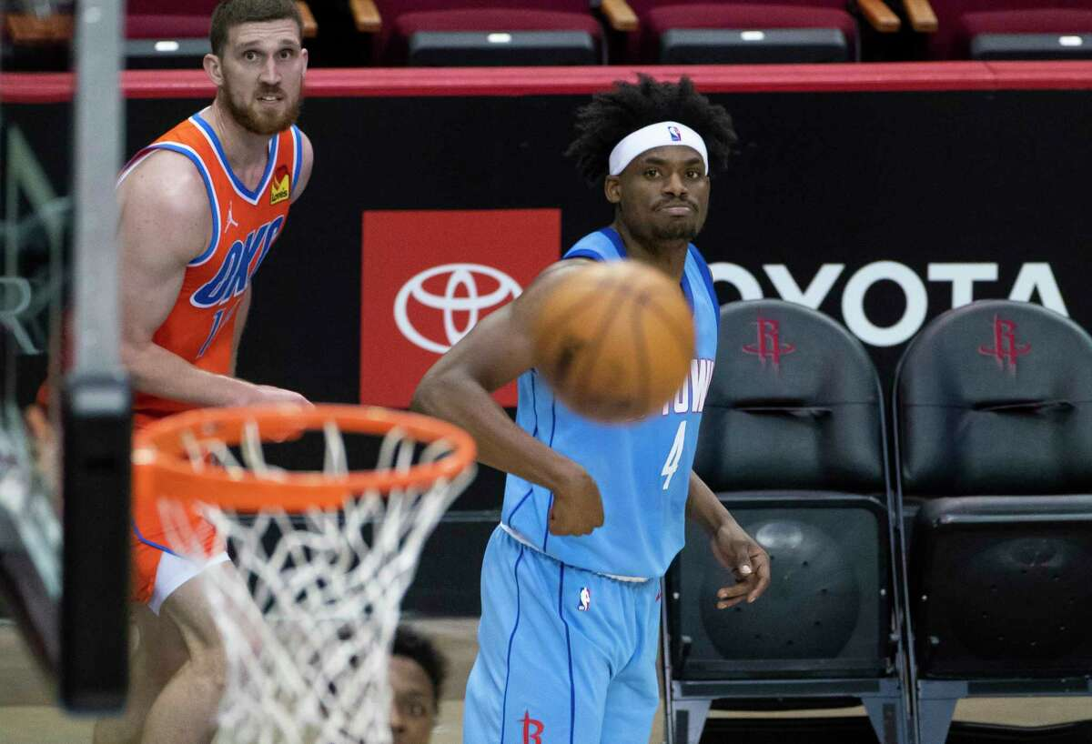 Houston Rockets forward Danuel House Jr. (4) misses a three point shot during the fourth quarter of an NBA game between the Houston Rockets and Oklahoma City Thunder on Sunday, March 21, 2021, at Toyota Center in Houston, TX.