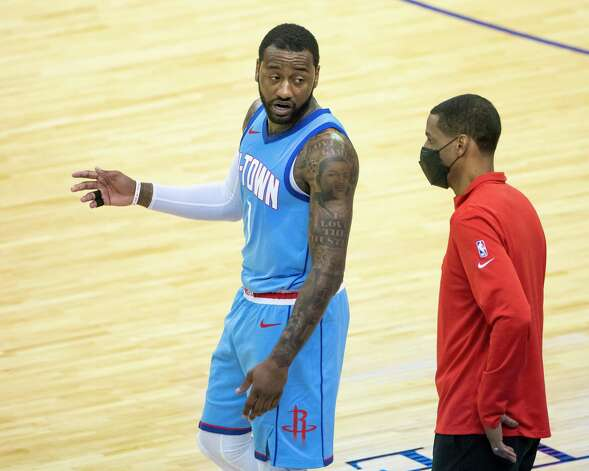 Houston Rockets guard John Wall (1) talks with Houston Rockets head coach Stephen Silas during the fourth quarter of an NBA game between the Houston Rockets and Oklahoma City Thunder on Sunday, March 21, 2021, at Toyota Center in Houston, TX. Photo: Mark Mulligan, Staff Photographer / © 2021 Mark Mulligan / Houston Chronicle