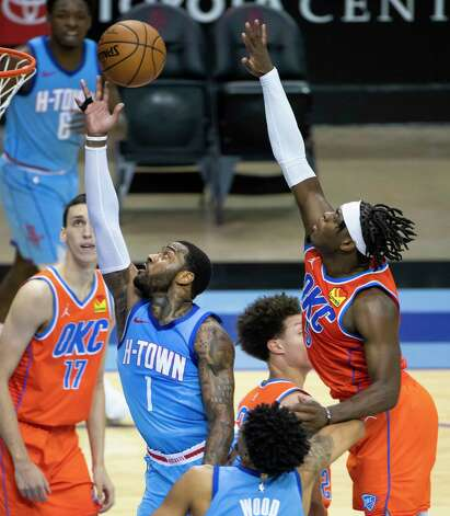 Houston Rockets guard John Wall (1) has a shot blocked by Oklahoma City Thunder forward Luguentz Dort (5) during the final minute of the fourth quarter of an NBA game between the Houston Rockets and Oklahoma City Thunder on Sunday, March 21, 2021, at Toyota Center in Houston, TX. Photo: Mark Mulligan, Staff Photographer / © 2021 Mark Mulligan / Houston Chronicle