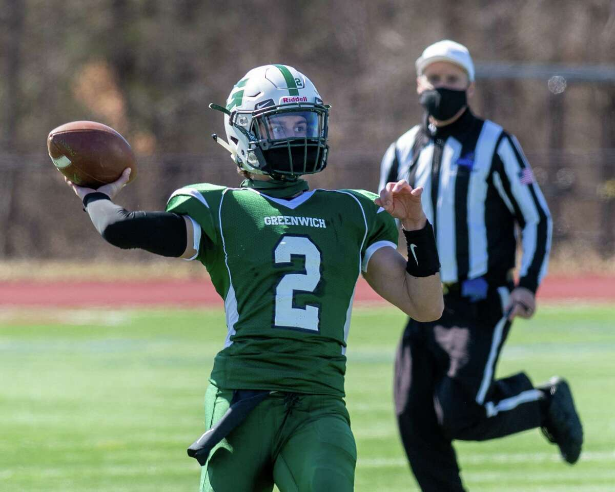 Greenwich quarterback Jesse Kuzmich, shown in a game in March, threw three touchdowns in the game against Cambridge/Salem on Saturday, Sept. 25, 2021.