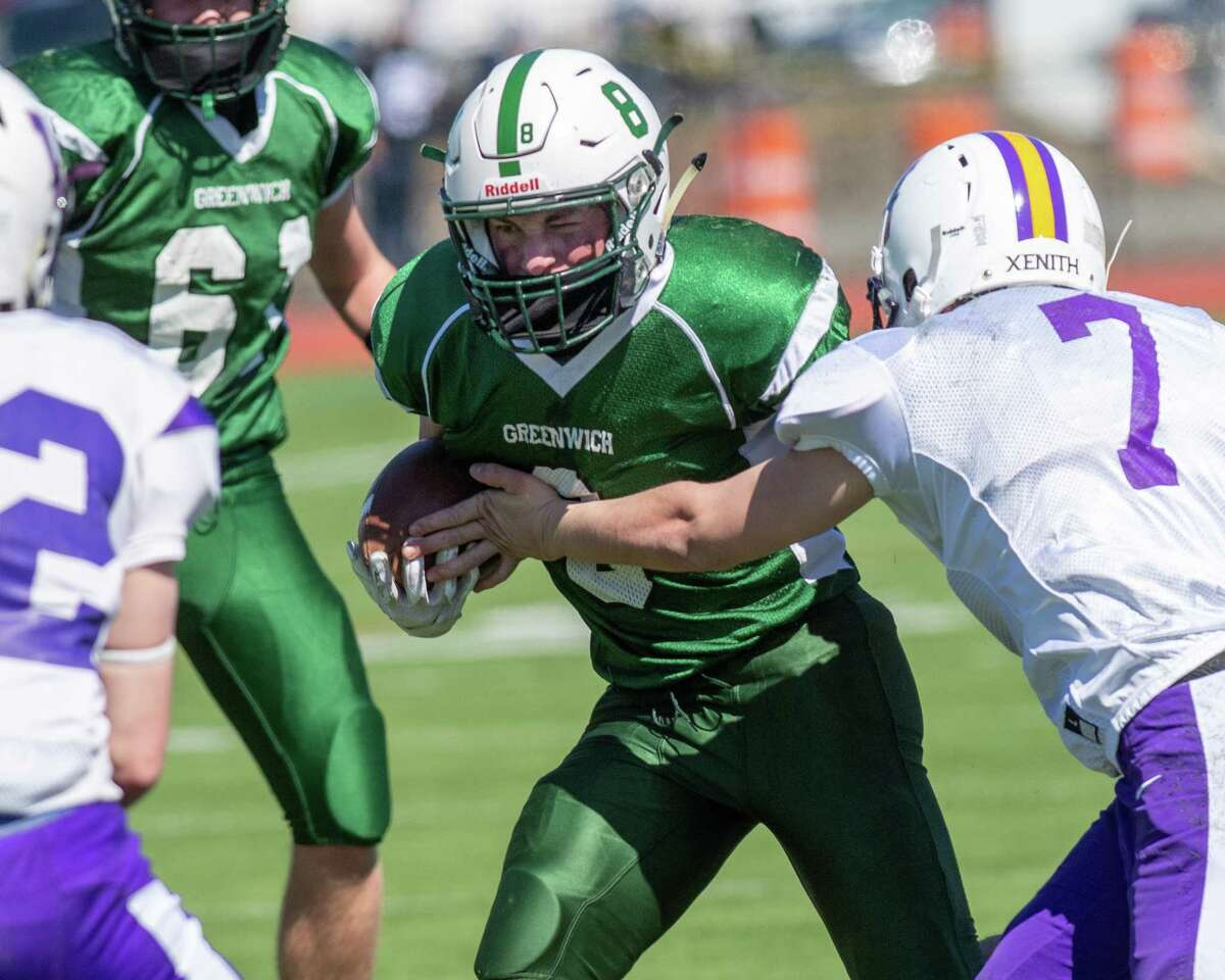 Greenwich running back Jackson Vanderhoff looks for room in front of Voorheesville defender Aidan Strauss at Stillwater High School in Stillwater, NY, on Sunday, March 21, 2021 (Jim Franco/special to the Times Union.)