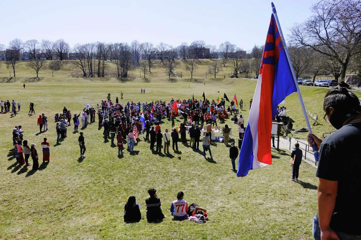 Supporters of people in Myanmar, formerly Burma, who are fighting against the military authorities and the military coup that recently took place in the country, gathered in Lincoln Park for a rally on Sunday, March 21, 2021, in Albany, N.Y. (Paul Buckowski/Times Union)