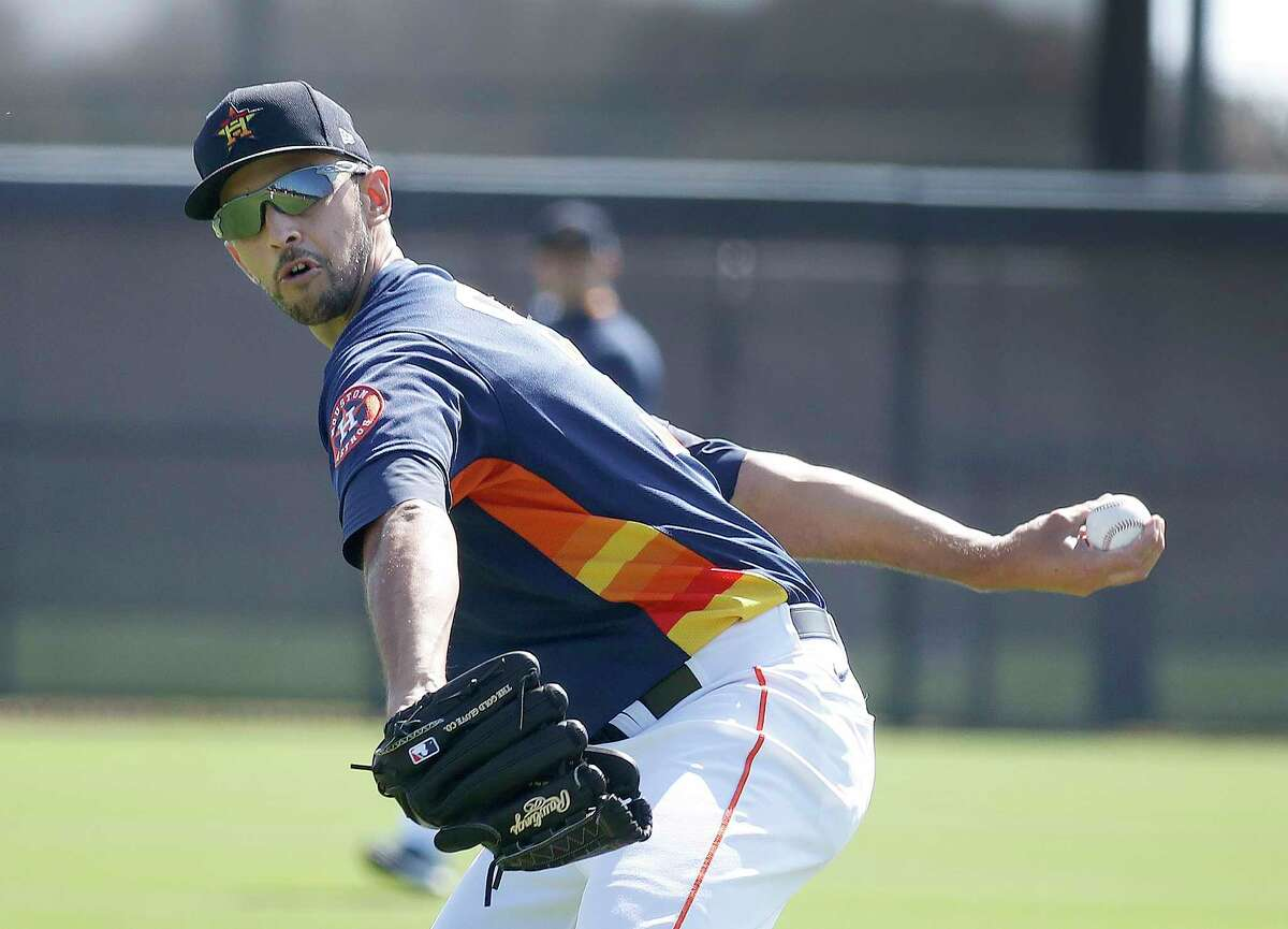 Houston Astros pitcher Steve Cishek (31) throws during spring training workouts for the Astros at Ballpark of the Palm Beaches in West Palm Beach, Florida, Thursday, February 25, 2021.