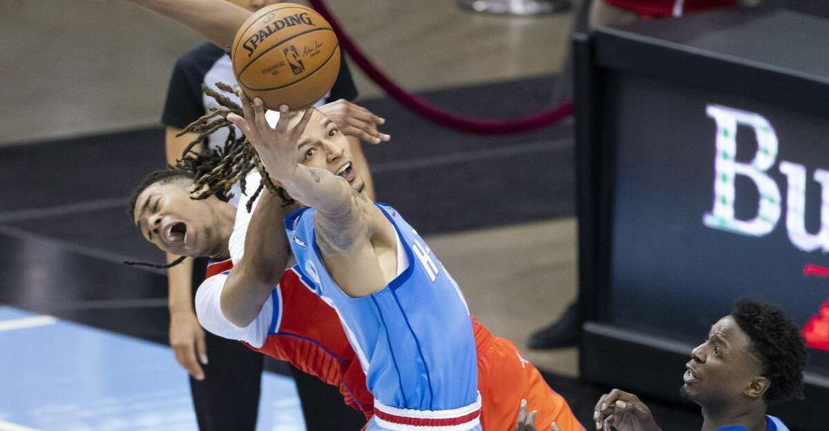 Houston Rockets forward D.J. Wilson (00) tries to grab a rebound during the fourth quarter of an NBA game between the Houston Rockets and Oklahoma City Thunder on Sunday, March 21, 2021, at Toyota Center in Houston, TX.