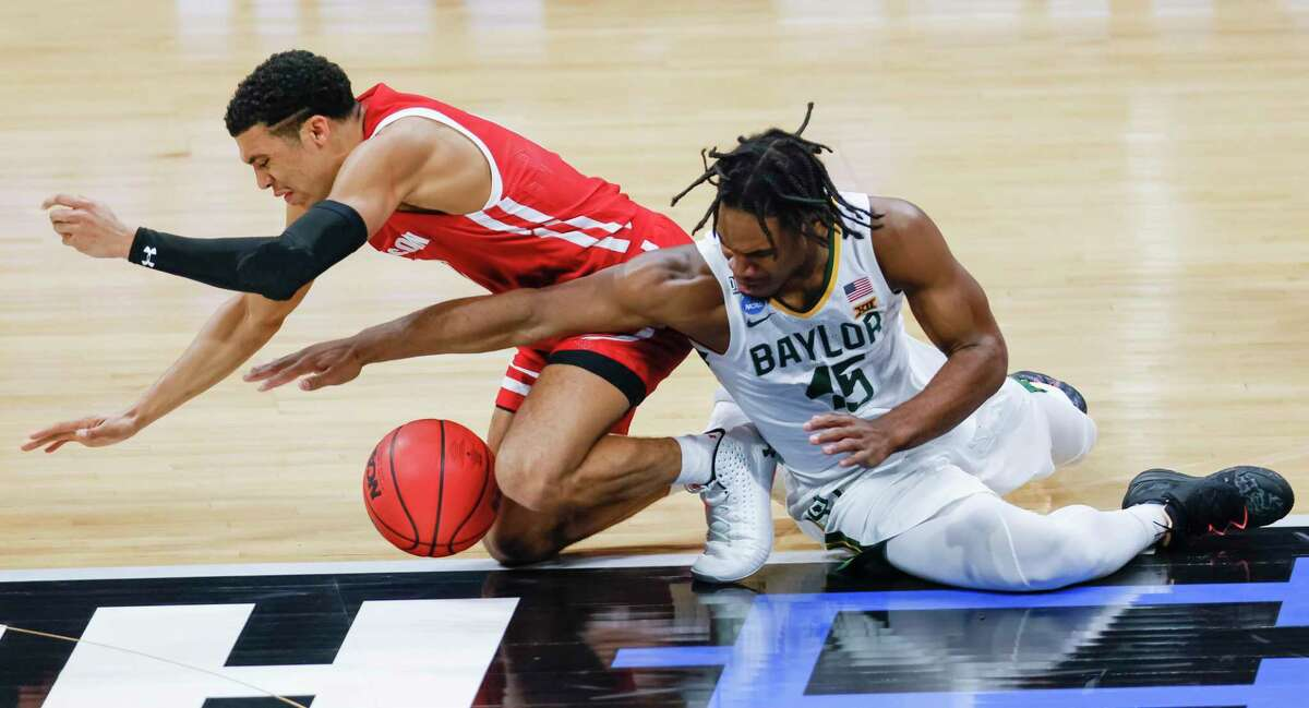 INDIANAPOLIS, IN - MARCH 21: D'Mitrik Trice #0 of the Wisconsin Badgers and Davion Mitchell #45 of the Baylor Bears scramble for the loose ball during the second half in the second round game of the 2021 NCAA Men's Basketball Tournament at Hinkle Fieldhouse on March 21, 2021 in Indianapolis, Indiana. (Photo by Michael Hickey/Getty Images)