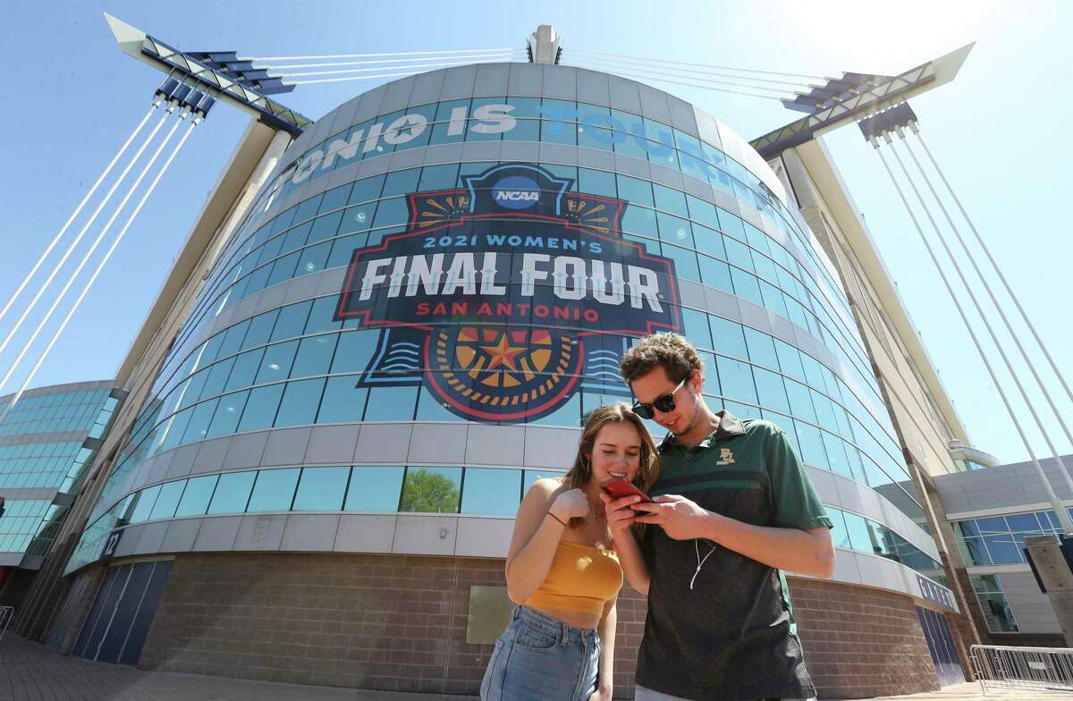 Baylor students Grant Rosen and Sarah Jones admire a picture they made in front the Alamodome and the logo for the NCAA Women's basketball tournament on Sunday, Mar. 21, 2021. They were attending the Baylor versus Jackson State game in the first round on Sunday.
