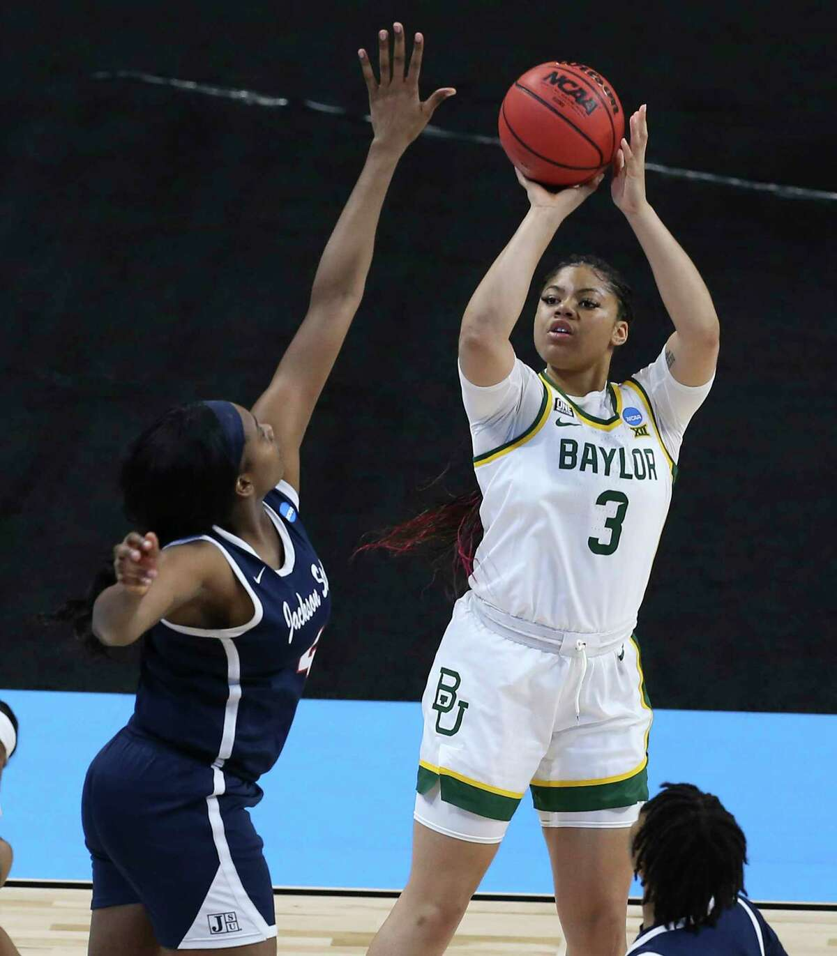 Baylor's Trinity Oliver (03) shoots over Jackson State's Ameshya Williams (04) in the first round of the 2021 NCAA Div. I Women's Basketball Championship at the Alamodome on Sunday, Mar. 21, 2021. Baylor defeated Jackson State, 101-52 to move onto the second round.