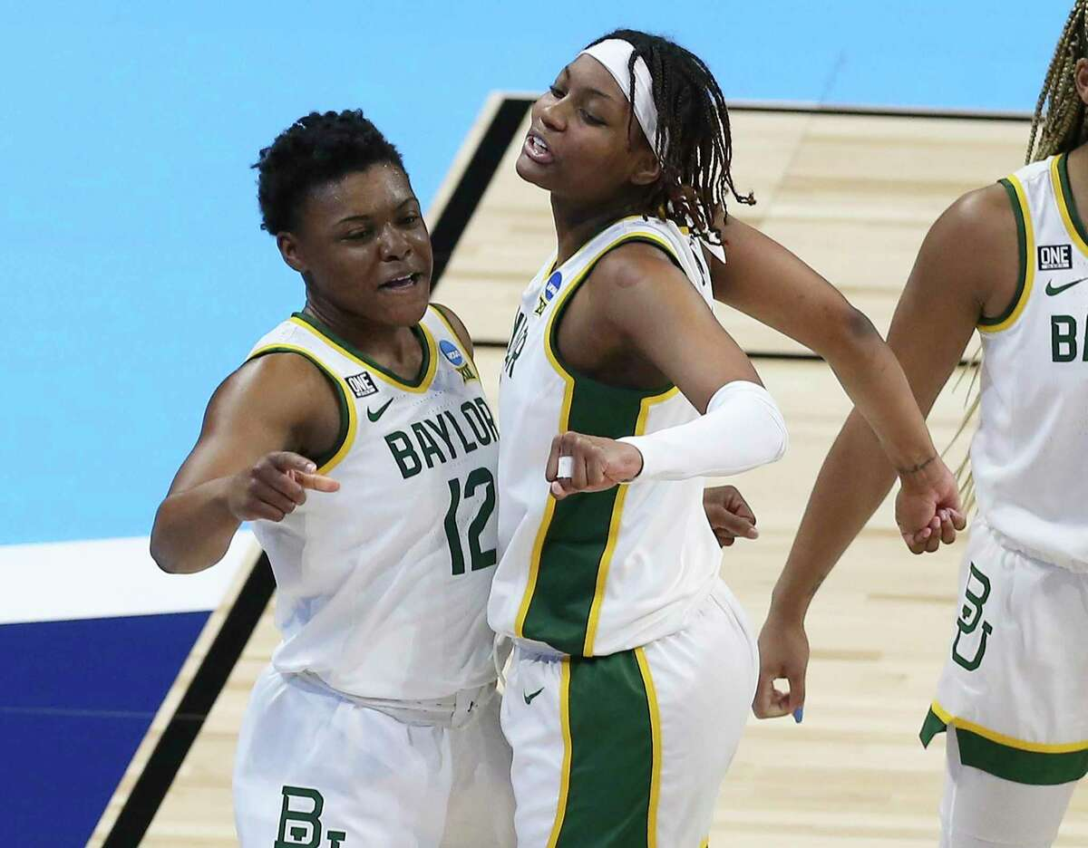 Baylor's Moon Ursin, left, and East Central product NaLyssa Smith celebrate during the Bears' 101-52 win.