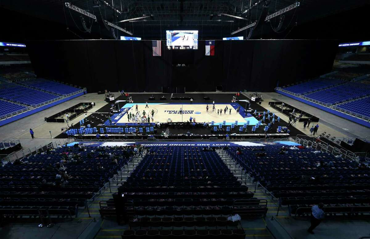 A sparse crowd watches No. 2-seed Baylor rout No. 15-seed Jackson State during the first round of the NCAA women's tournament Sunday at the Alamodome. Fewer than 400 fans on player and coach pass lists were allowed in the venue.