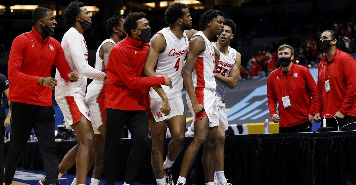 The Houston Cougars celebrate defeating the Rutgers Scarlet Knights 63-60 in the second round game of the 2021 NCAA Men's Basketball Tournament at Lucas Oil Stadium on March 21, 2021 in Indianapolis, Indiana. (Photo by Jamie Squire/Getty Images)