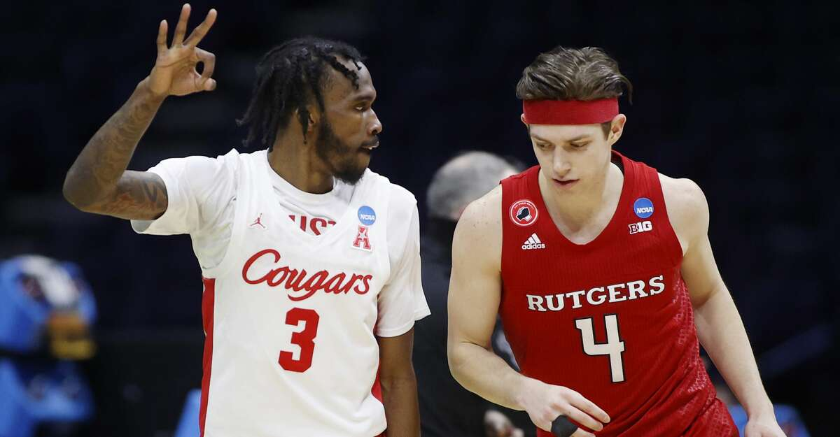 DeJon Jarreau #3 of the Houston Cougars reacts next to Paul Mulcahy #4 of the Rutgers Scarlet Knights during the first half in the second round game of the 2021 NCAA Men's Basketball Tournament at Lucas Oil Stadium on March 21, 2021 in Indianapolis, Indiana. (Photo by Jamie Squire/Getty Images)