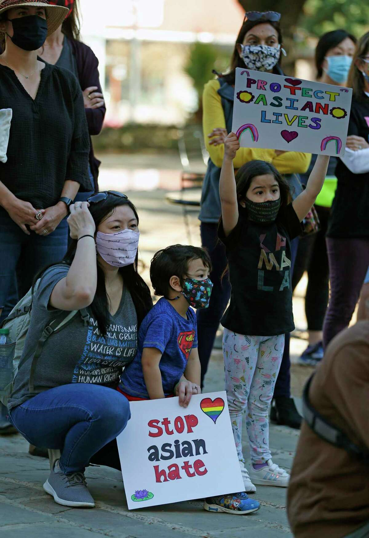Minh Nguyen, with her children Leila Marroquin, 6, and Adrian Marroquin, 3, attend a vigil against anti-Asian hate crimes and racism Saturday in Main Plaza.