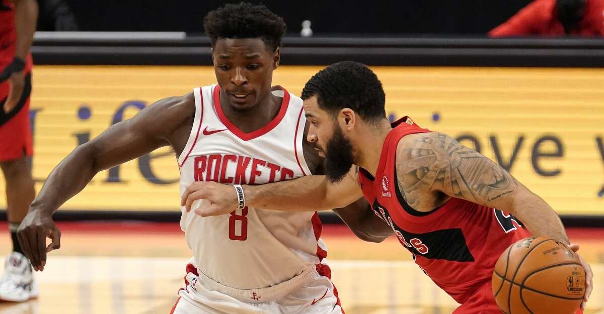 Toronto Raptors guard Fred VanVleet (23) drives around Houston Rockets forward Jae'Sean Tate (8) during the first half of an NBA basketball game Friday, Feb. 26, 2021, in Tampa, Fla. (AP Photo/Chris O'Meara)