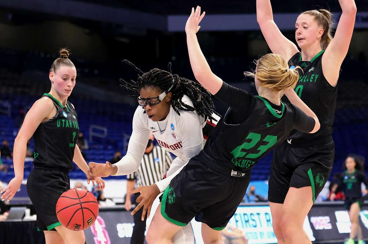 Francesca Belibi #5 of the Stanford Cardinals and Madison Grange #23 of the Utah Valley Wolverines battle for a loose ball during the second half in the first round game of the 2021 NCAA Women's Basketball Tournament at the Alamodome on March 21, 2021 in San Antonio, Texas.