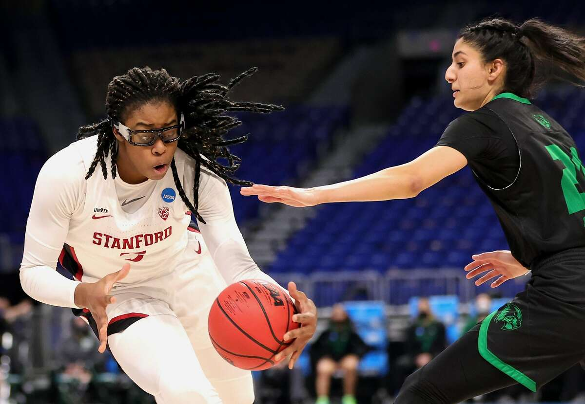 Francesca Belibi #5 of the Stanford Cardinals controls the ball around Nehaa Sohail #21 of the Utah Valley Wolverines during the second half in the first round game of the 2021 NCAA Women's Basketball Tournament at the Alamodome on March 21, 2021 in San Antonio, Texas.