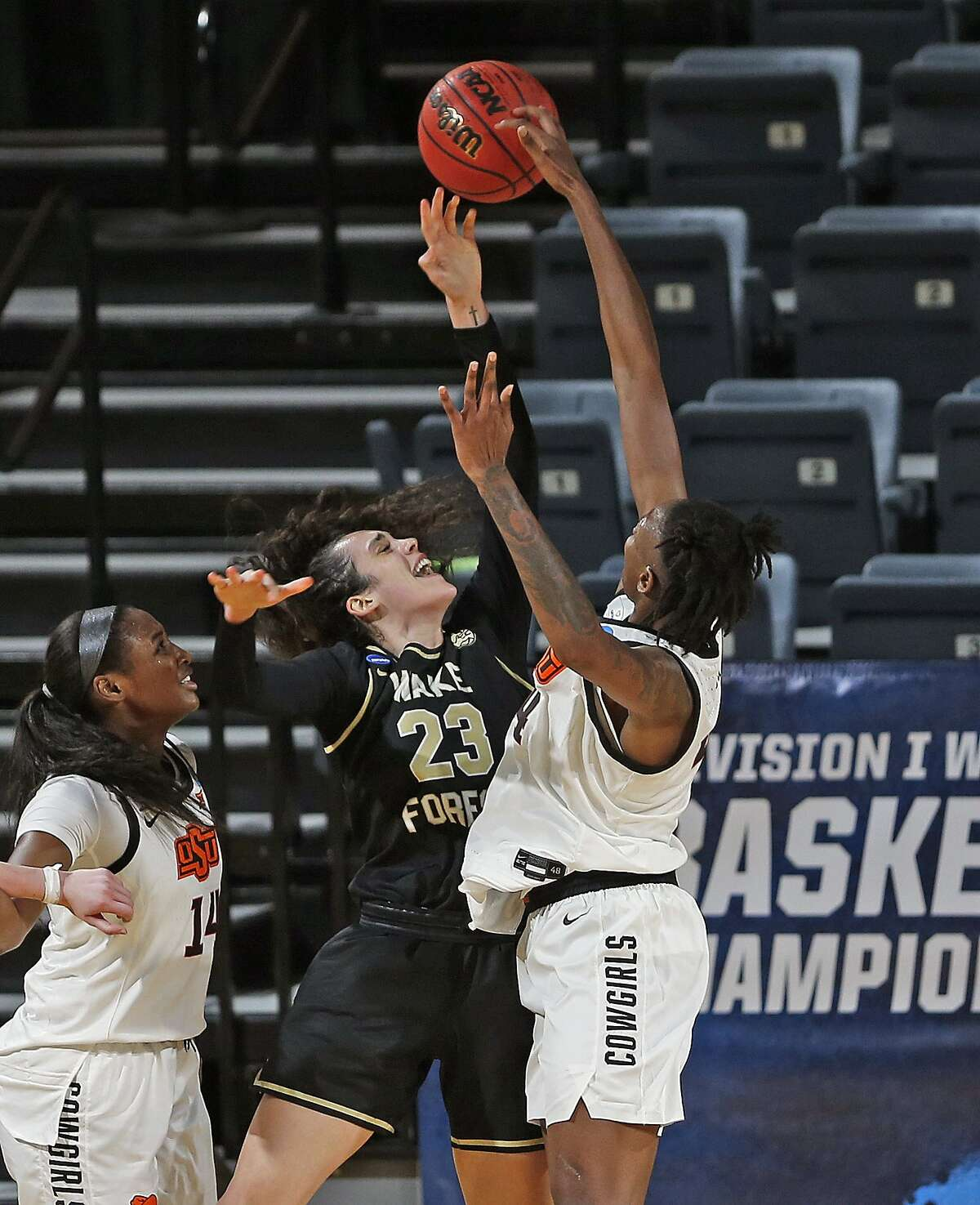 Oklahoma State forward Natasha Mack(4) blocks shot attempt of Wake Forest forward Christina Mora during the second half of a college basketball game in the first round of the women's NCAA tournament at the Greehey Arena in San Antonio, Texas, Sunday, March 21, 2021. (AP Photo/Ronald Cortes)