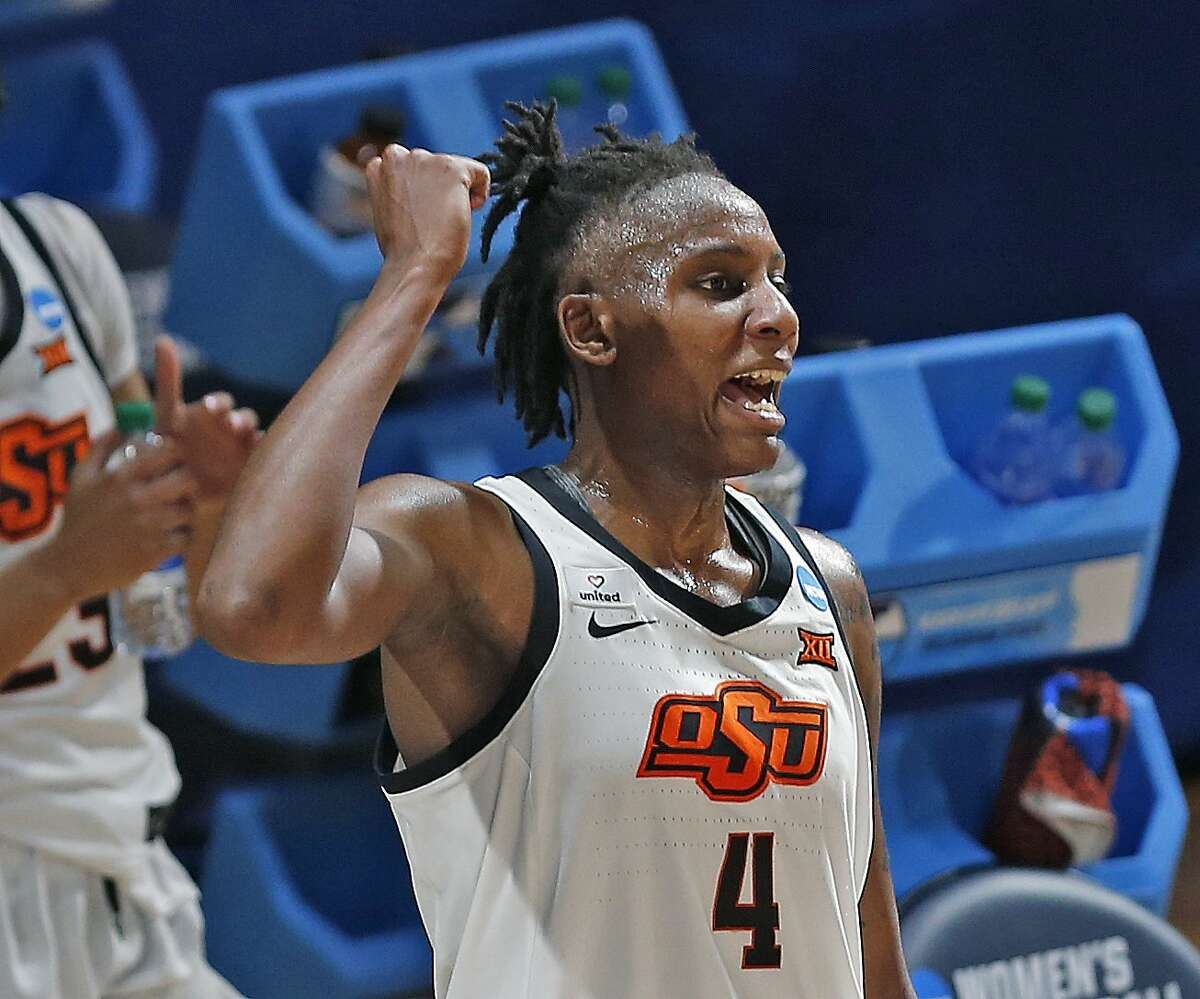 Oklahoma State forward Natasha Mack(4) celebrates as the clock ticks down during the second half of a college basketball game in the first round of the women's NCAA tournament at the Greehey Arena in San Antonio, Texas, Sunday, March 21, 2021. (AP Photo/Ronald Cortes)